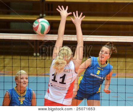 KAPOSVAR, HUNGARY - OCTOBER 21: Zsanett Pinter (R) in action at a Hungarian NB I. League volleyball game Kaposvar (blue) vs Godollo (white), October 21, 2011 in Kaposvar, Hungary.