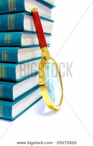 Pile Of Green Books And Magnifier