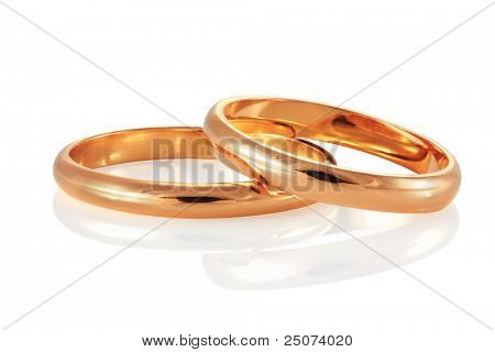 Golden wedding rings, isolated on the white background, clipping path included.