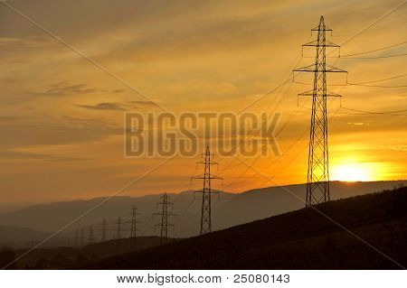 Electricity Pylons In The Dusk