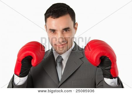 Close up of businessman prepared to fight against a white background