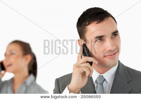 Close up of business partners talking on the cellphone against a white background