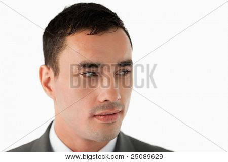 Close up of businessman looking to his left against a white background