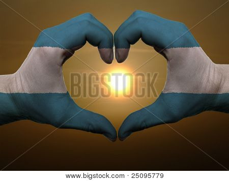 Heart And Love Gesture By Hands Colored In El Salvador Flag During Beautiful Sunrise