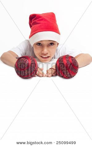 Boy In Christmas Red Hat Holding Red Decorative Balls