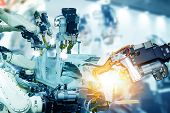Iot Smart Factory , Industry 4.0 Technology Concept, Robot Arm In Automation Factory Background With poster