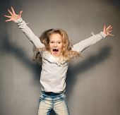 Screaming girl. Crazy child. Naughty, disobedient kid poster