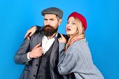 Amorous Happy Couple. Handsome Bearded Man Embracing With Girlfriend. Trendy Couple In Warm Clothes. poster