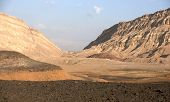stock photo of bagpack  - Hiking in Negev desert of Israel  - JPG