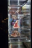 Display Of Dry Aged Meat Steaks In Butchers Shop Or Restaurant In An Display Refrigerator poster