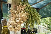 Bunches Of Garlic And Tea Herbal Hung Out To Dry Outdoor poster