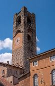 Bergamo, Italy - May 10, 2018: Bell Tower, Clock Tower. Ancient Architecture Of Old Town Or Upper Ci poster