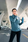 Runner Wiping Out Sweat After Workout At The Parking Lot Outside poster