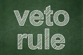 Politics Concept: Text Veto Rule On Green Chalkboard Background poster