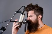 Bearded Man Singing With Microphone. Concert&music Concept. Brutal Bearded Guy Singer With Microphon poster