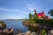 Lighthouse On A Rocky Coast. The Eagle Harbor Lighthouse On The Rocky Shore Of Lake Superior. Eagle  poster