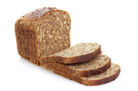 stock photo of whole-grain  - Sliced brown bread with whole grain - JPG