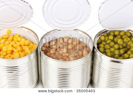 Open tin cans of corn, beans and peas isolated on white