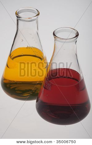 Flasks with yellow and red liquids