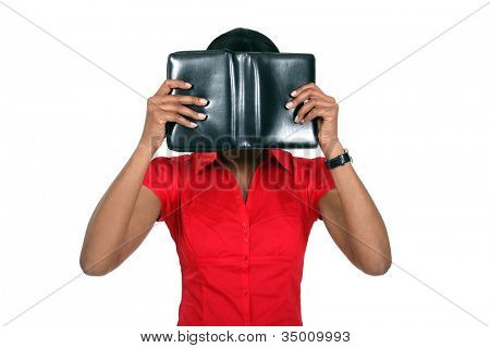Woman hiding her face behind a leather-bound book