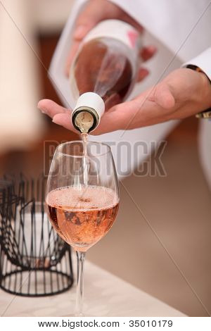Waiter pouring sparkling wine