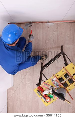 worker in action on a wall