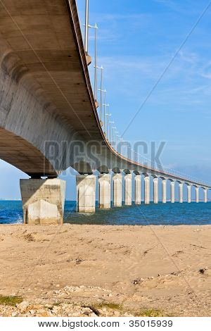 Curved Concrete Bridge Over The Water