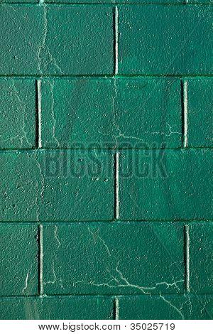 Cracked Green Cynder Block Wall