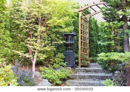 Garden Entrance With Arbor And Stone Steps