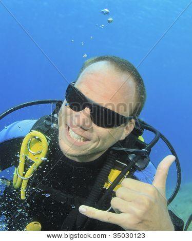 Scuba Diver signals call me