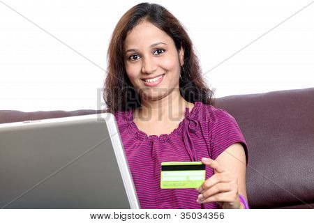 Young Woman Online Shopping From Home