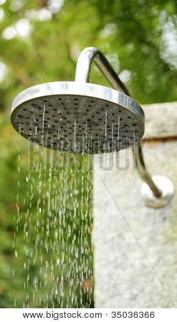 Metal Water Shower In The Open Outdoors At A Hotel Spa With Fresh Clean Water Droplets Dripping Out