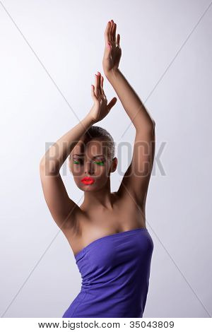 sexy woman in dance with glow make-up