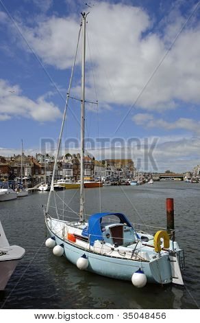 Sailing boat moored in Weymouth harbour in Dorset, England.
