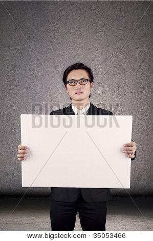 Businessman Holding Blank Banner