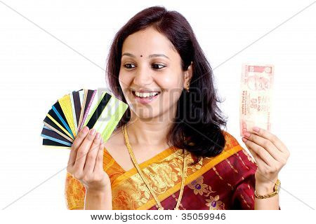 Woman With Indian Currency And Credit Cards