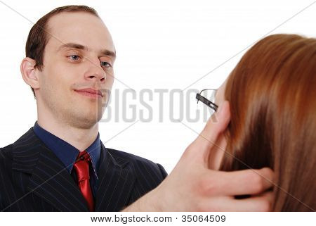 Young Man Tries On Glasses To The Young Girl