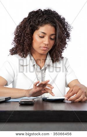 Portrait of female doctor using digital tablet at work isolated on white background.