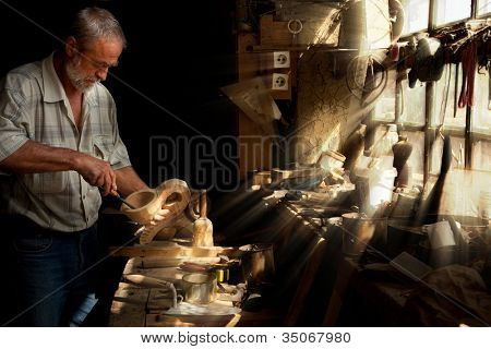 Summer sun beams shining on the hands of a skilled carpenter