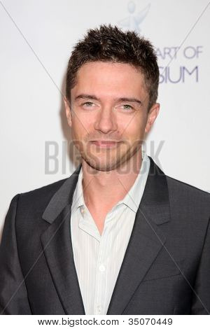 LOS ANGELES - JUN 9:  Topher Grace arriving at the Art of Elysium Return of Ford Mustang Boss Event at The Residences at W Hollywood on June 9, 2011 in Los Angeles, CA