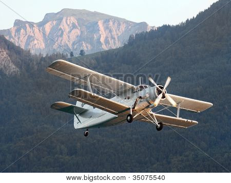 ST. WOLFGANG, AUSTRIA - JULY 7: Famous soviet plane paradropper Antonov An-2 Heritage of Flying Legends.  Historic biplane in Air Challenge on July 7, 2012 in St. Wolfgang.