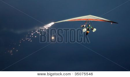 ST. WOLFGANG, AUSTRIA - JULY 7: Rare hand glider exhibition during a famous nightshow in Air Challenge on July 7, 2012 in St. Wolfgang.