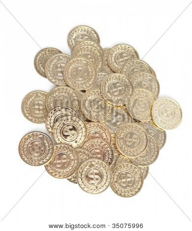 Scattered gold coins, isolated on white background. A great number of coins symbolize wealth, richness, income and profit. Close up shot.