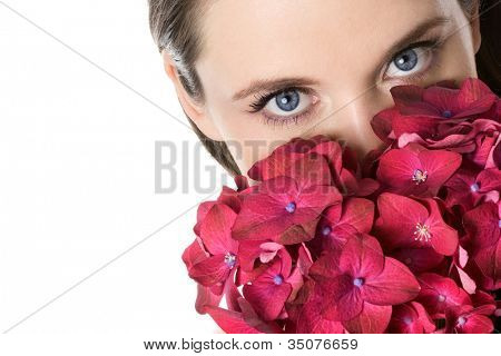 Woman and pink flowers. Space for text.