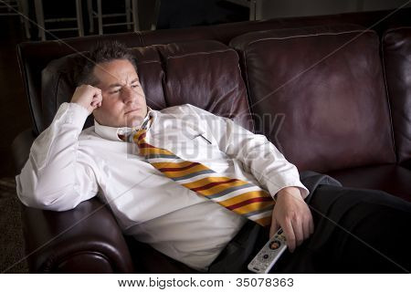 Lazy Male watching Television at home