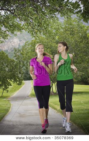 Beautiful Female runners on a path