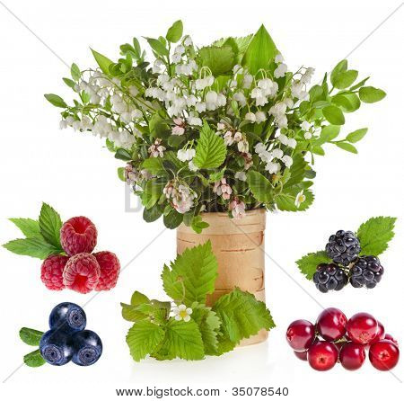 bouquet of lilies-of-the-valle  with bloom blueberries cowberries on birch vase