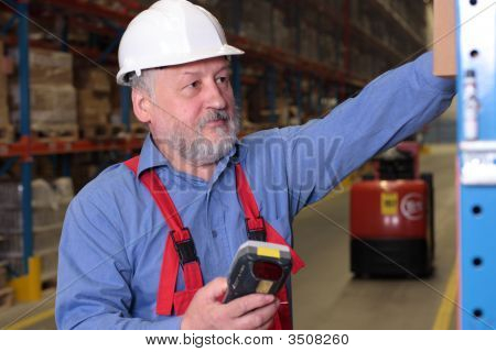 Senior Worker With Bar Code Reader