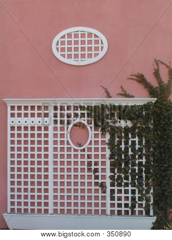 Pink Stucco And White Lattice