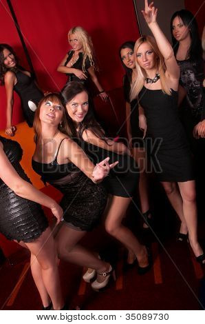 Image of pretty girls dancing in night club